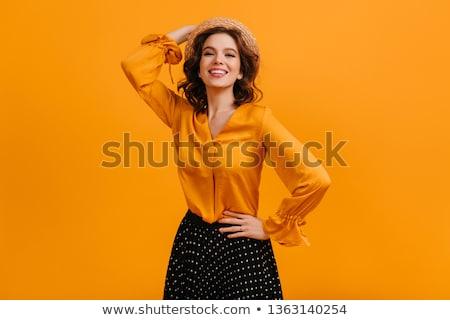 Mooie jonge vrouw Geel blouse geïsoleerd witte Stockfoto © Elnur
