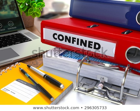 Red Ring Binder with Inscription Confined. Stock photo © tashatuvango