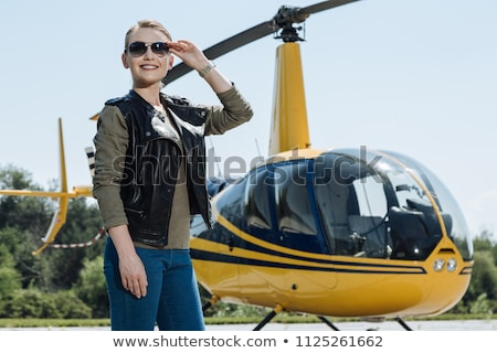Fiatal pilóta pózol helikopter komoly égbolt Stock fotó © vlad_star