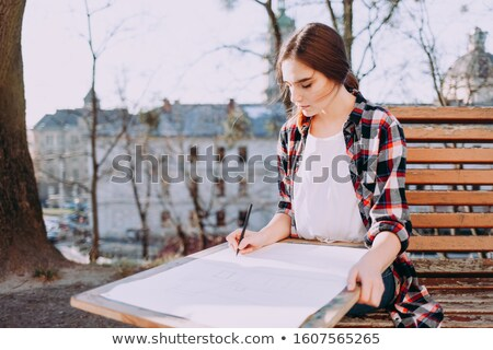 happy pretty woman painter with tablet stock photo © deandrobot