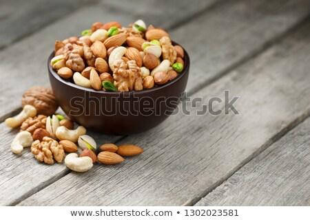 hazelnuts on brown wooden table stock photo © artjazz