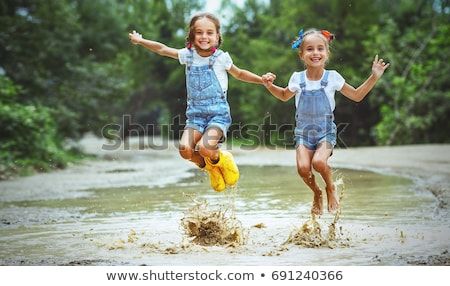 kid girl toddler playing jumping in park outdoor  Stock photo © lunamarina