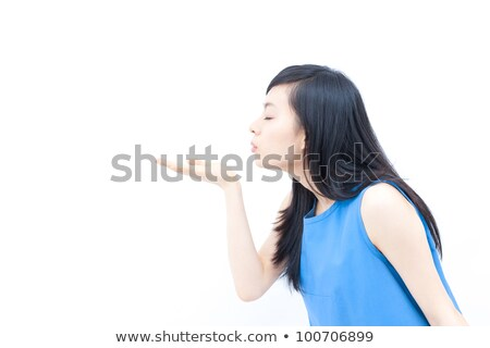 Relaxed pretty young woman blowing a kiss Stock photo © Giulio_Fornasar