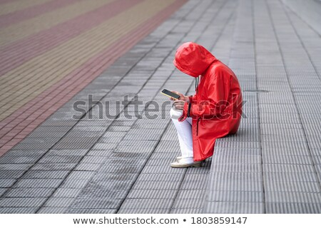 close up of addict woman hiding her face on street Stock photo © dolgachov