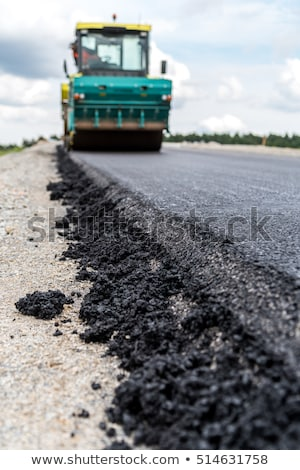 Road roller compacting asphalt  Stock photo © smuki