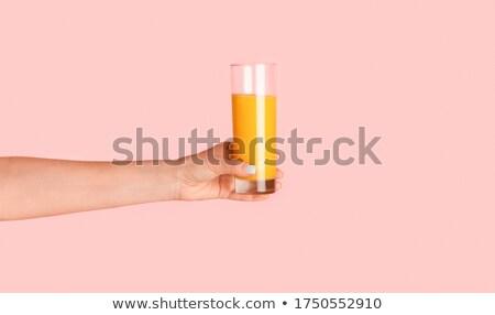 hand holds orange juice stock photo © artjazz