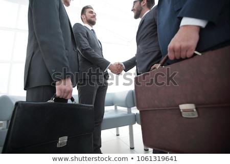 Caucasian business man holding briefcase. Stock photo © RAStudio