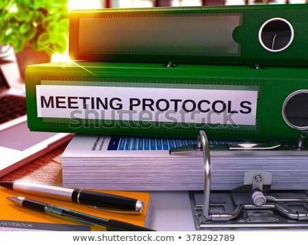 Meeting Protocols on Green Ring Binder. Blurred, Toned Image. Stock photo © tashatuvango