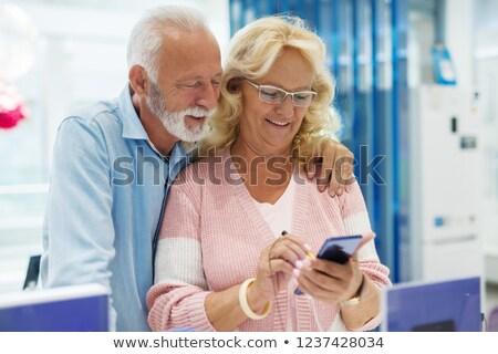 senior man on phone behind screen stock photo © is2