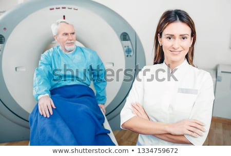 Two doctors, smiling, x-rays behind Stock photo © IS2