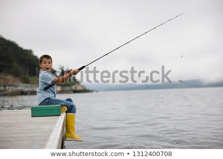 Chłopców połowów netto posiedzenia wypoczynku Zdjęcia stock © IS2
