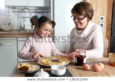 girls with grandmother cooking jam Stock photo © IS2
