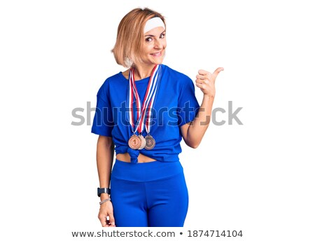 Female athlete wearing a medal and showing thumbs up Stock photo © wavebreak_media