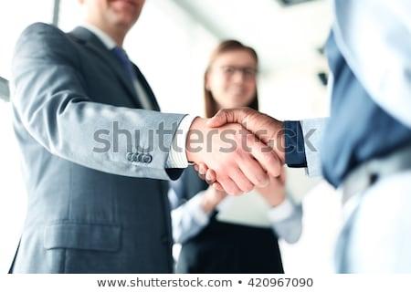 Gente de negocios apretón de manos acuerdo cooperación mujer hombre Foto stock © stokkete