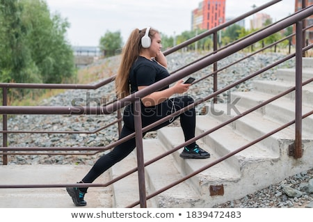 Plus-size model in earphones Stock photo © Traimak