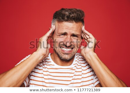 Ongelukkig man gestreept tshirt schreeuwen hoofdpijn Stockfoto © deandrobot