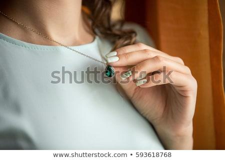 Hand holding stylish necklace. Stock photo © marylooo
