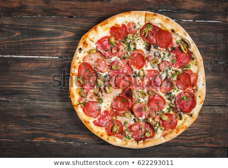Rustic old style vintage pizza Stock photo © Peteer