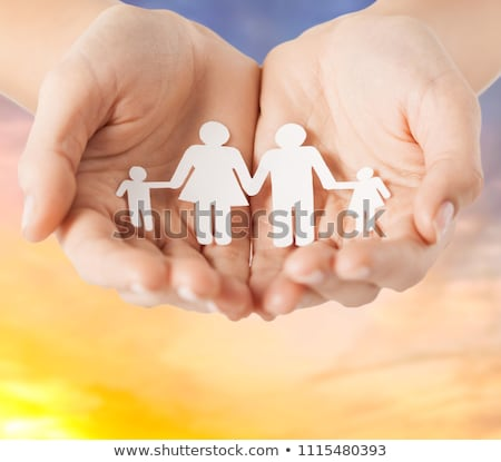 female hands with paper family pictogram Stock photo © dolgachov