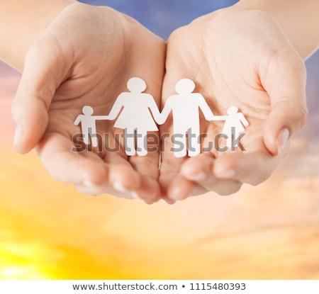Kobiet ręce papieru rodziny piktogram ludzi Zdjęcia stock © dolgachov