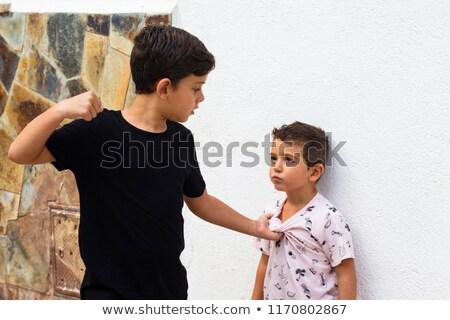 Big boy bullying on little boy Stock photo © colematt