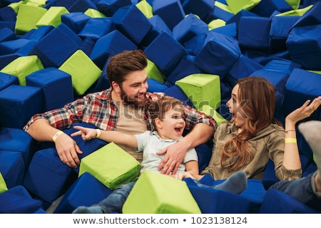 young woman playing with soft blocks at indoor children playground in the foam rubber pit in the tra stock photo © galitskaya