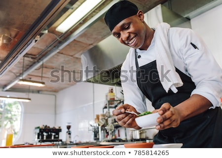 happy male chef cooking food at restaurant kitchen Stock photo © dolgachov