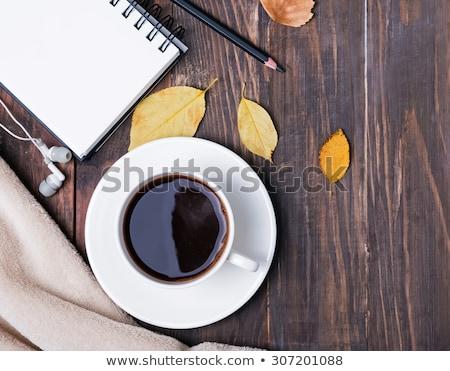 Noir casque tasse café portable note Photo stock © Illia