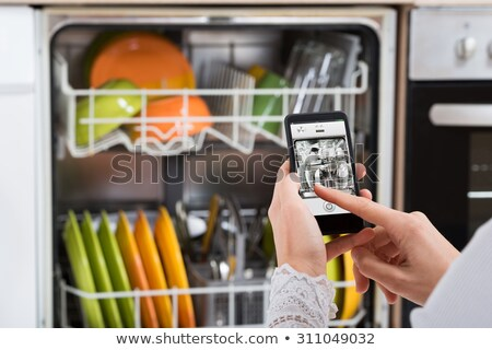 kadın · bulaşık · makinesi · yandan · görünüş · genç · kadın · mutfak · gülümseme - stok fotoğraf © andreypopov