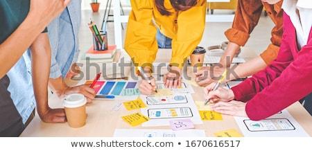 Equipe trabalhando usuário interface projeto escritório Foto stock © dolgachov