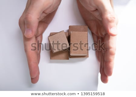 Close-up Of Hand Holding Miniature Movable Cardboard Boxes Stock photo © AndreyPopov