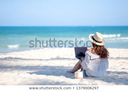 Donna seduta spiaggia cocco mano Foto d'archivio © AndreyPopov