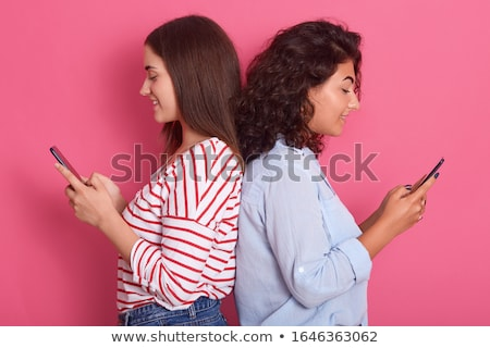 Shocked beautiful young woman posing isolated over pink background take care of her skin holding cos Stock photo © deandrobot