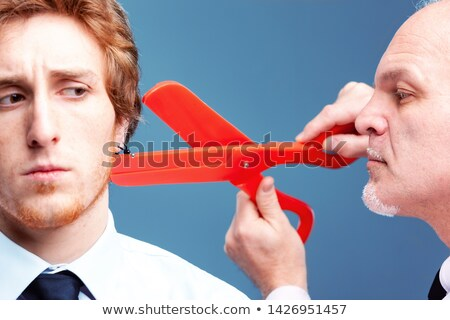 Manager or boss preparing to snip off an earring Stock photo © Giulio_Fornasar