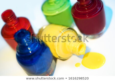 five colors of nail polish on dark background stock photo © elly_l