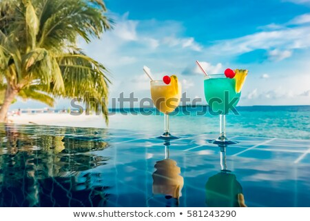Coconut water drink by the Swimming pool  Stock photo © dashapetrenko