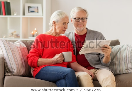 woman reading newspaper on christmas at home Stock photo © dolgachov