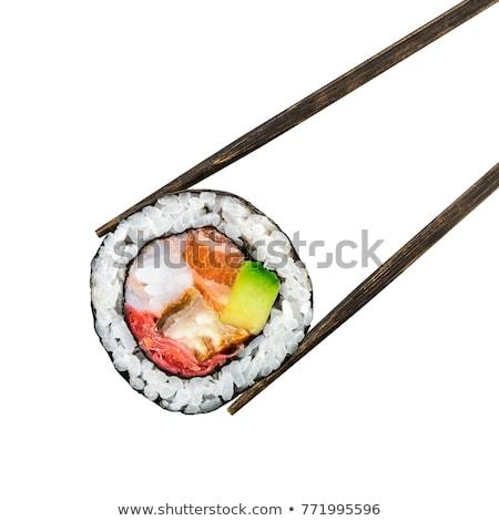 Somon sushi rulo Çin yemek çubukları taş tahta Stok fotoğraf © OleksandrO