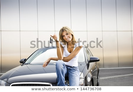 Stock photo: Woman  Holding key in front of car