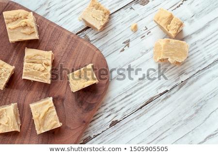 Finom házi készítésű mogyoróvaj négyzetek rusztikus fa asztal Stock fotó © StephanieFrey