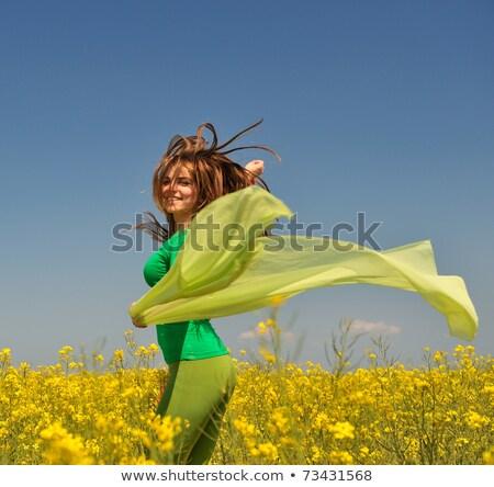 mulher · dança · campo · jovem · feliz · amarelo - foto stock © lichtmeister