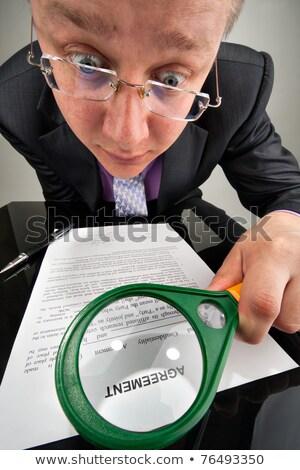 Dziwaczny biznesmen umowy obiektyw Zdjęcia stock © nomadsoul1