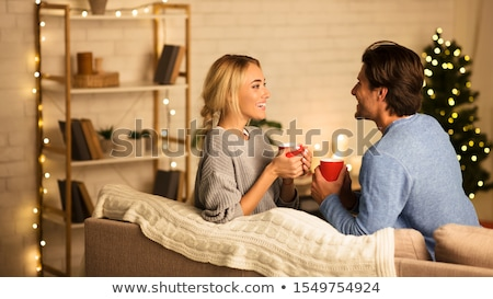 happy couple talking at home in evening Stock photo © dolgachov