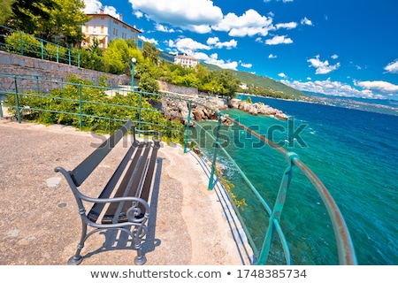 Bench by the sea on Lungomare walkway in town of Lovran Stock photo © xbrchx
