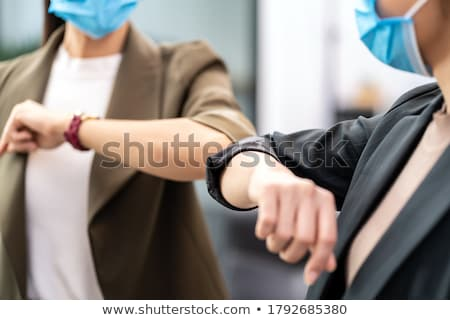 People Doing Elbow Bump To Prevent Covid-19 Virus Spread Stock photo © AndreyPopov