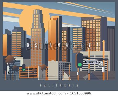 Los Angeles City skyline golden silhouette. Stock photo © ShustrikS