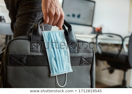 man with a briefcase and a surgical mask Stock photo © nito
