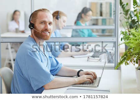 Call Center Medical Service. Happy Doctor Stock photo © AndreyPopov
