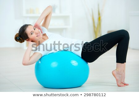 Woman balancing on inflatable gym ball Stock photo © photography33