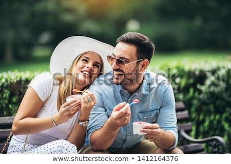 portre · genç · kadın · yeme · dondurma · oturma - stok fotoğraf © HASLOO